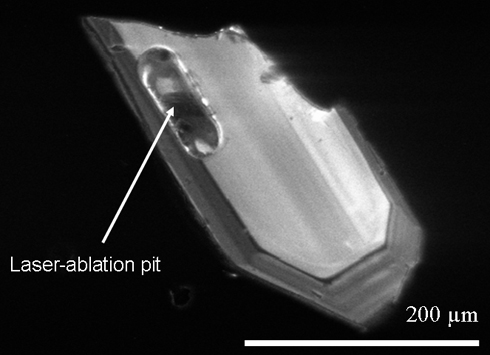 Cathodoluminescence image of a zircon crystal showing a laser ablation pit