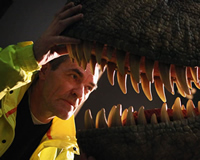Museum engineer Martin Kirkby looks into the jaws of Tarbosaurus
