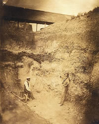 Workers point to the hand axe uncovered in the gravel mine in 1859
