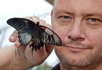 Butterfly house manager Luke Brown with the rare dual-sex great mormon butterfly