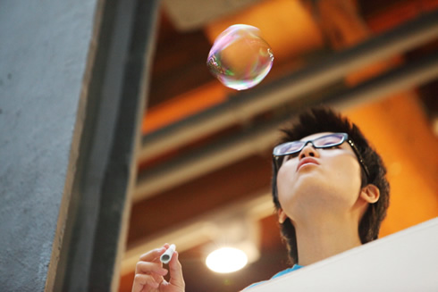 Blow bubbles to measure wind speed and direction and record your results in the climate survey