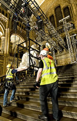 Eight people worked to move the Darwin statue up the main staircase.