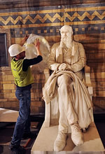 Final preparations are made to the Darwin statue.