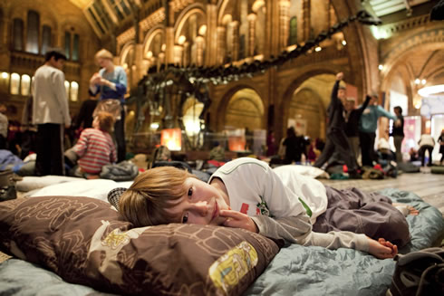 Mack Pegram prepares his sleeping bag in the Central Hall at the Museum's first DinoSnores sleepover