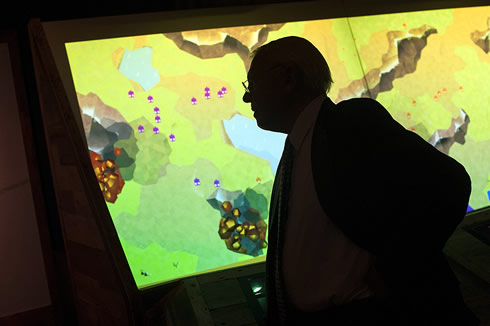 Sir David Attenborough in front of the interactive game at the opening of Museum's Extinction exhibi
