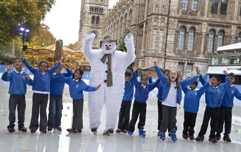Snowman and kids from Cyril Jackson primary school at London's Natural History Museum Ice Rink 2011