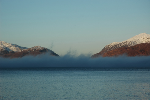 A bank of fog extends across Loch Linnhe in Argyll.
