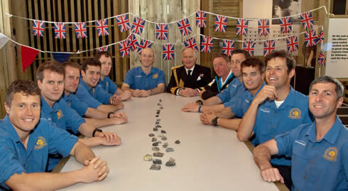 Spirit of Scott servicemen sit at the table in the recreation of the hut in Scott's Last Expedition