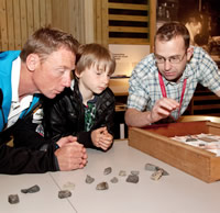 David Smith talks to one of the servicemen and his son about the rocks Scott and his team collected
