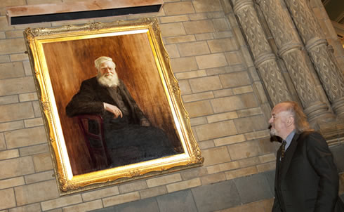 Comedian and naturalist Bill Bailey unveils the portrait of Wallace at launch