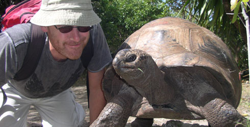 Julian Hume and a tortoise
