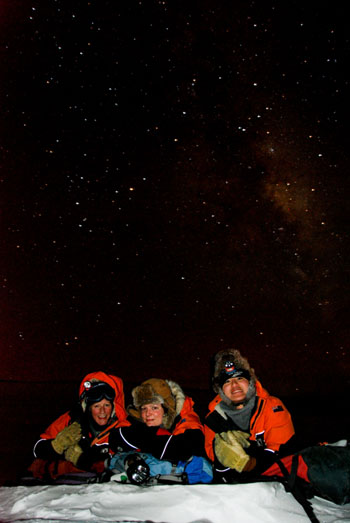 Aurora hunters - Sandy, Jane and Steven lying on the ice lake at the top of Crater Hill © Antarctic Heritage Trust