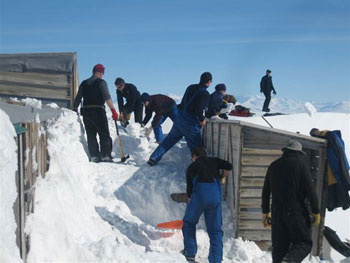 The annual clearing of snow from the walls of Cape Evans © Antarctic Heritage Trust