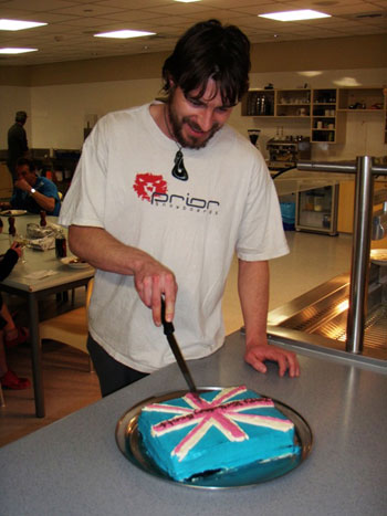 Tom, Scott Base Winter Manager, makes the first cut in Scott's birthday cake © AHT / M Bell