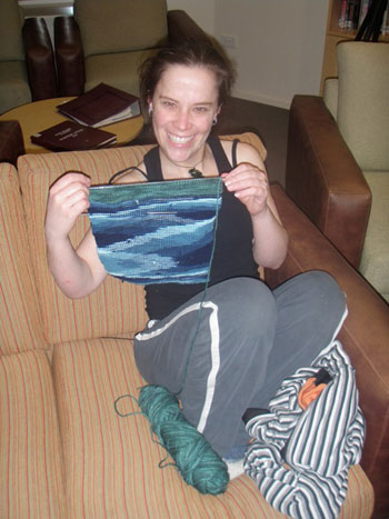 Bobbie, Scott Base Winter Chef, proudly displays her knitting project © Antarctic Heritage Trust