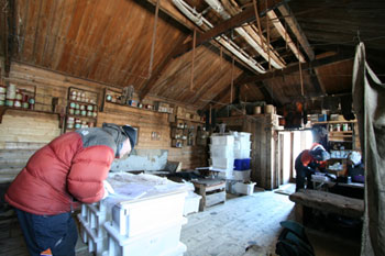 Al, Anna and Lizzie working in the hut at Cape Royds © Antarctic Heritage  Trust