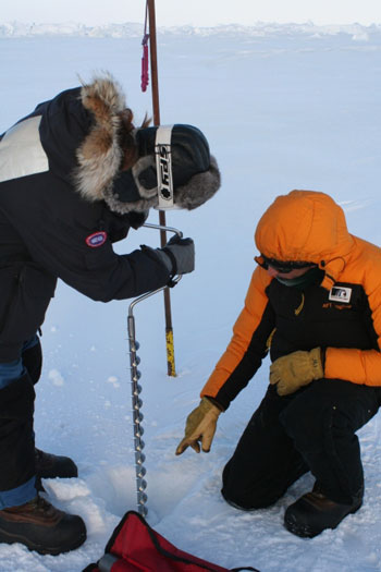 Ian and Anna drilling to check the thickness of the ice © Antarctic Heritage Trust