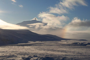Erebus veiled in cloud in April with the plume of fumes above the crater © AHT / N Dunn