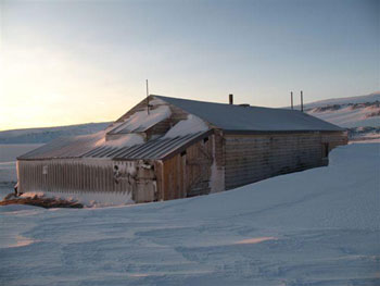 Captain Scott's 1910 base at Cape Evans.  The stables and latrine area are in the foreground. © Antarctic Heritage Trust