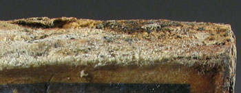 Fatty deposits and scoria on the surface of one of the soap boxes © Antarctic Heritage  Trust