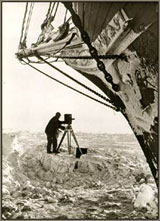 Frank Hurley taking photographs near the ship © Antarctic Heritage  Trust