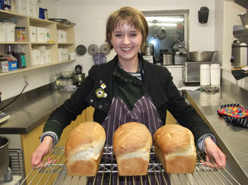 George proudly showing her first ever bread loaves © Alf Shinkelshoek / Antarctica New Zealand