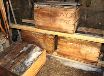 Three crates of whisky and two of brandy being stored at Cape Royds after excavation from under the hut this summer © Antarctic Heritage Trust