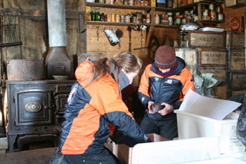 Anna and Jana unpacking artefacts © Antarctic Heritage  Trust