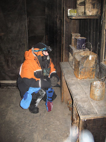 Inspection of artefacts in Discovery Hut © Antarctic Heritage Trust