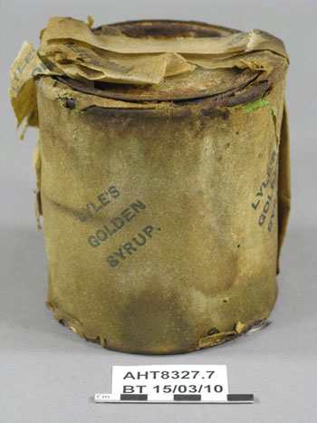 Tin of Lyle's Golden Syrup with its wrapper before treatment © AHT / M Bell
