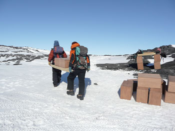 Al and Jana using one of our box carrying stretchers © Antarctic Heritage  Trust