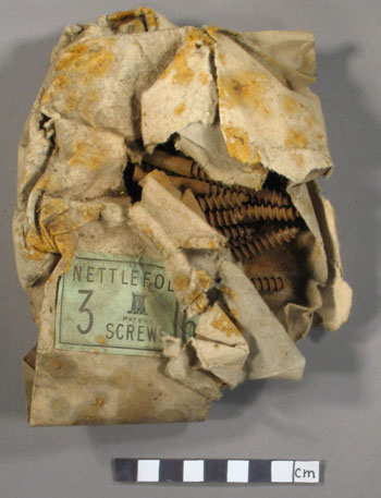 Nettlefolds screw packet before treatment © Antarctic Heritage  Trust