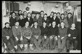 The 1957 Scott Base winter group photo taken in the TAE hut and hung in the hallway at Scott Base © John Claydon, Antarctica NZ Pictorial Collection