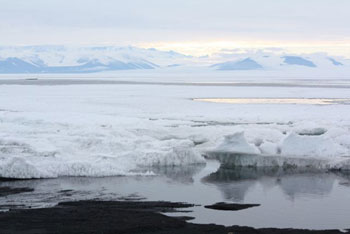 Dark patches of water hinting at the sea to come © Antarctic Heritage Trust