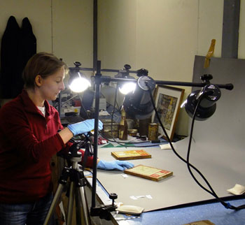 Nicola documents an artefact - the bulbs in our photographic lights are energy efficient © Antarctic Heritage Trust / M Bell