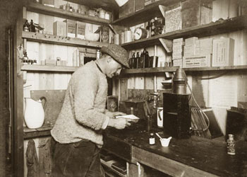 Herbert Ponting in his darkroom at Captain Scott's base, Cape Evans, March 1911 © Alexander Turnbull Library ref PA1-f-067-030-1