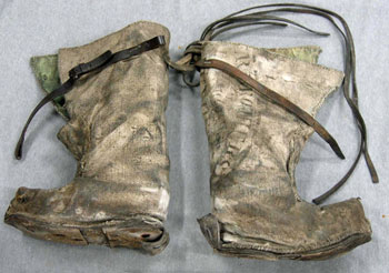 A pair of improvised boots made by the Ross Sea Party, which would have been made from whatever they could scavenge from Captain Scott's base at Cape Evans © Antarctic Heritage Trust