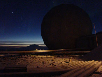 Satellite silhouette and sky-line showing Mt. Erebus with the lights of McMurdo and Scott Base below © Dan Gordon