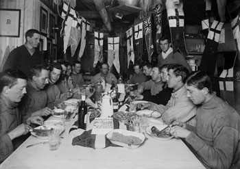 Captain Scott's birthday dinner at Cape Evans, June 6th 1911 © Herbert Ponting / SPRI