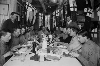 Captain Scott's last birthday dinner, 6 June 1911 © Herbert Ponting / Scott Polar Research Institute