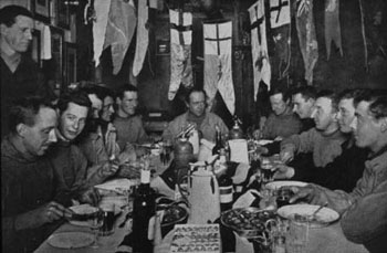 Scott at the head of the table during his birthday celebration © Antarctic Heritage  Trust