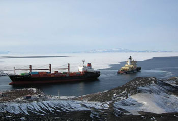 Container ship being towed away from American base McMurdo by a Russian ice-breaker © Antarctic Heritage Trust / N Dunn