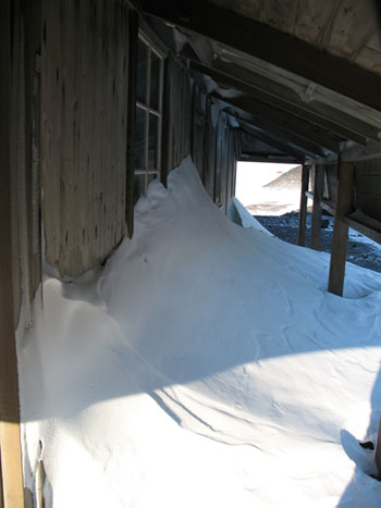 Snow build up under the verandah © Antarctic Heritage Trust