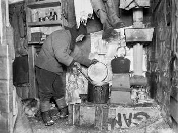 The stove in use in the stables around 1911 © Scott Polar Research Institute