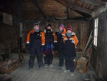 The team inside Discovery Hut © Antarctic Heritage Trust