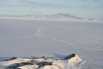 Sea ice between Ross and Black Islands, with Discovery Hut and the road to Cape Evans in the foreground © Antarctic Heritage Trust