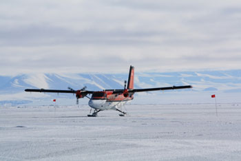 Twin Otter landing on the sea ice outside our camp © Antarctic Heritage  Trust